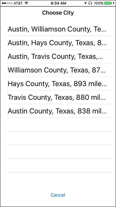 Screenshot of the Choose City screen on Nearby Explorer displaying a list of matching cities