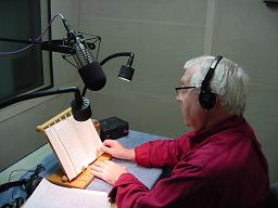 Photo of APH narrator reading a book